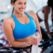 Gym woman with a bottle of water — Stock Photo