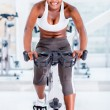 Fit woman doing spinning — Stock Photo