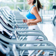 Woman running on a treadmill — Stock Photo