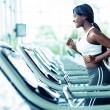 Woman running on a treadmill — Stock Photo #26905339