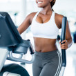 Stock Photo: Fit womexercising at gym