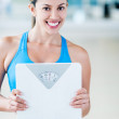Gym woman with a weight scale — Stock Photo