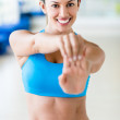Woman stretching before exercising — Stock Photo