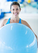 Gym woman with Pilates ball — Stock Photo