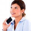 Thoughtful woman with a cell phone — Stock Photo #27011475