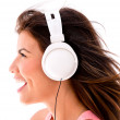 Woman listening to music — Stock Photo #27055419