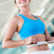 Gym woman taking measurements — Stock Photo #27309485