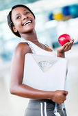 Fit woman eating healthy — Stock Photo