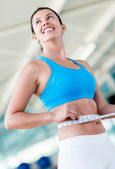 Gym woman taking measurements — Stock Photo