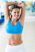 Gym woman stretching — Stock Photo
