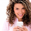 Stock Photo: woman texting on her phone