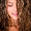 Foto Stock: Womwith curly hair