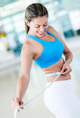 Gym woman loosing weight — Stock Photo