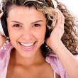 Happy woman listening to music — Stock Photo