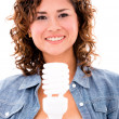 Woman with an energy saving bulb — 图库照片