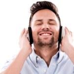 Happy man listening to music — Stock Photo