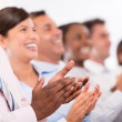 Foto Stock: Happy business group applauding