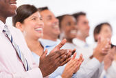 Happy business group applauding — Stock Photo