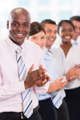Happy business team applauding — Stock Photo