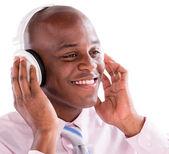 Business man with headphones — Stock Photo