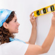 Woman using a level tool — Stock Photo