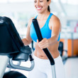 Woman exercising at the gym — Stock Photo