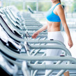 Stock Photo: Womwalking on treadmill