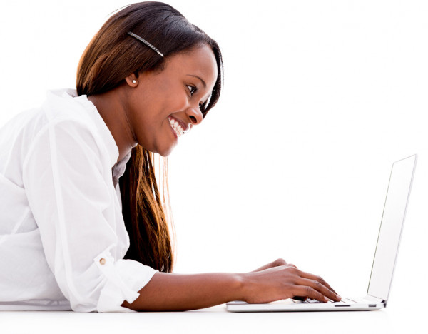 Woman using a laptop — Stock Photo #28487815
