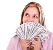 Thoughtful woman with money — Stock Photo