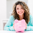 Woman saving money — Stockfoto #29575189