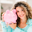 Stock Photo: Happy womwith piggybank
