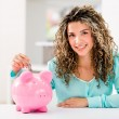 Woman saving money — Stock Photo