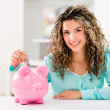 Stock Photo: Womsaving money