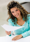 Business woman handling documents — Stock Photo