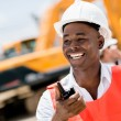 Construction worker with a walkie talkie — Stock Photo #29804955