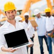 Construction worker with a computer — Stock Photo