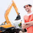 Stock Photo: Man working with contruction machines