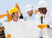 Group of architects at a construction site — Stock Photo