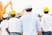 Architects looking at a construction site — Stock Photo