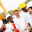 Group of workers at a building site — Stock Photo