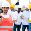 Construction worker with a walkie talkie — Stock Photo