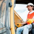 Construction worker operating a crane — Stock Photo