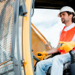 Stock Photo: Construction worker operating crane