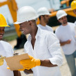 Architects working at a construction site — Stock Photo