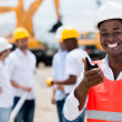 Construction worker talking on a radio — Stock Photo