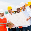 Group of workers at a construction — Stock Photo