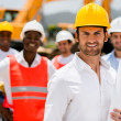Architect with a group of construction workers — Stock Photo