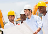 Engineers holding a blueprint — Stock Photo