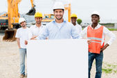 Architect holding a banner — Stock Photo