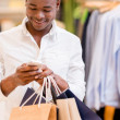 Stock Photo: Shopping mtexting